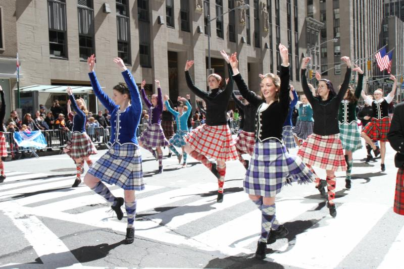 Dancers clad in Scottish kilts march in New York City Tartan Day Parade
